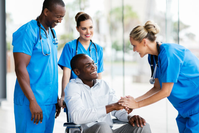 female-doctor-greeting-disabled-patient.jpg