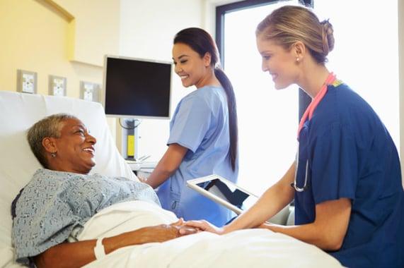 nurse-tablet-taling-to-senior.jpg