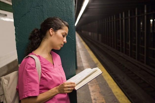 nurse-waiting-subway-reading.jpg